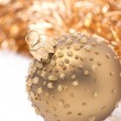Golden Christmas ball and tinsel, close-up, isolated — Stock Photo #34347393