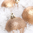 Golden Christmas balls in white tinsel, selective focus — Stock Photo
