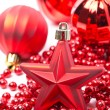 Red Christmas decorations - the star and balls — Stock Photo