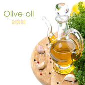 Bottle of olive oil, garlic, spices and fresh herbs, isolated — Stock Photo