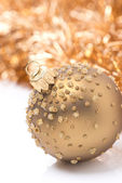 Golden Christmas ball and tinsel, close-up, isolated — Stock Photo