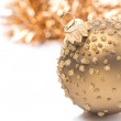 Golden Christmas ball and tinsel, isolated — Stock Photo #34638317