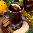 Two glasses of mulled wine with spices in glass and cookies — Stock Photo #34638397