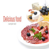 Assorted deli meats and a plate of cheese, isolated — Stock Photo