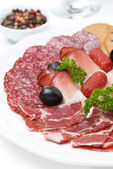 Assorted deli meats on a plate, close-up — Stock Photo