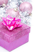 Christmas composition with pink gift box and baubles, isolated — Photo