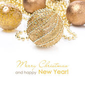 Composition with different golden Christmas balls, isolated — Stockfoto