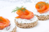 Festive appetizer - canape with rye bread, cream cheese, salmon — Stock Photo