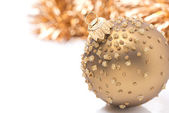 Golden Christmas ball and tinsel, isolated — Foto Stock
