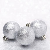 Silver Christmas balls and bokeh, close-up, selective focus — Stock Photo
