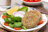 Vegetarian burgers made from lentils and buckwheat on the plate — Stock Photo