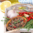 Spices and fresh herbs on a wooden tray — Stock Photo