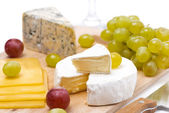 Three kinds of cheese and grapes isolated, selective focus — Stok fotoğraf