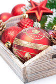 Wooden box with Christmas decorations, close-up — Stock fotografie