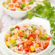 Salad with corn, green peas, rice, red pepper and tuna, close-up — Stock Photo