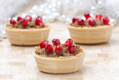 Tartlets with liver pate and pomegranate seeds for Christmas — Stock Photo
