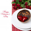 Festive table setting with red hearts and roses, isolated — Stock Photo