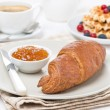 Sweet breakfast with croissant, jam, waffles, berries and coffee — Stock Photo #35771947