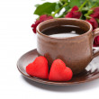 Cup of coffee, red candy, gift and roses for Valentine's Day — Stock Photo #35995857