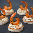 Festive appetizer with spicy shrimps on toast — Stock Photo