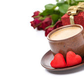 Cup of espresso, red candy, gift and roses for Valentine's Day — Stock Photo