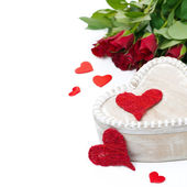 Wooden box, red hearts and roses for Valentine's Day — Stock Photo