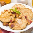 Homemade pancakes with peaches and honey, top view — Stock Photo #36355769