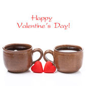 Cups of coffee and candy in the the shape of heart  — Stockfoto