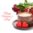 Cup of black coffee, candy, gift and roses for Valentine's Day — Stock Photo