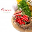 Fresh chili pepper garlic, spices and oil on a wooden board — Stock Photo #36565565