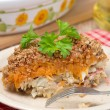 Gratin with fish and pumpkin on a plate, vertical — Stock Photo