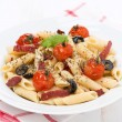 Pasta with sausage, tomatoes and olives — Stock Photo