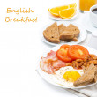 Traditional English breakfast with fried eggs, bacon and beans — Stock Photo