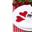 Two wicker heart on a plate and red roses, isolated — Stock Photo