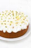 Orange cake with Greek yogurt, honey and pistachios on a plate — Stock Photo