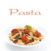 Pasta with sausage, cherry tomatoes and olives on the plate — Stock Photo