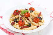 Pasta with sausage, tomatoes and olives — Foto de Stock