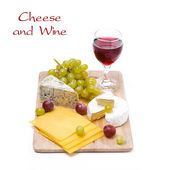 Three kinds of cheese, grapes and wine, isolated — Stock Photo