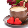 Cup of coffee, red candy, gift and roses for Valentine's Day — Stock Photo