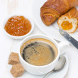 Fresh breakfast with black coffee, croissants and orange jam — Stock Photo
