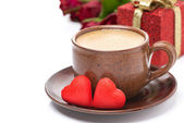 Cup of coffee, red candy, gift and roses for Valentine's Day — Photo