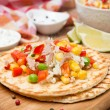 Colorful vegetable salad with tuna and cream sauce on tortillas — Stock Photo #37210329