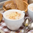 Delicious cream soup of cauliflower with cheese and pepper — Stock Photo