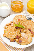 Pancakes with peaches and honey for breakfast, top view — Stock Photo