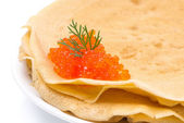 Stack of crepes with red caviar on a plate, close-up — Stock Photo