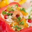 Stuffed peppers with salad of rice and shrimp on a wooden board — Stock Photo