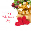 Stock Photo: Golden gift box, two red hearts and flowers, isolated