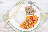 Chinese food - rice, chicken and vegetables with shrimp, top vie — Stock Photo