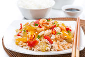 Chinese food - white rice with vegetables and shrimps on a plate — Stock Photo