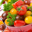 Assorted fresh cherry tomatoes, herbs and spices, close-up — Stock Photo